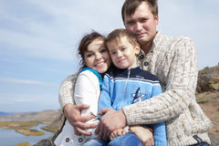 Happy family on the mountain with lake Stock Photography