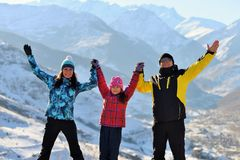 Happy family on a mountain top on a Sunny winter hold hands. royalty free stock photos