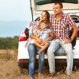 Happy family. Family in the mountains by car Royalty Free Stock Photography