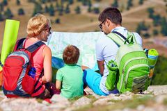 Happy family in mountains discussing the route Royalty Free Stock Photo
