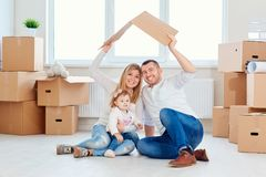 A happy family moves to a new apartment. stock photos