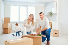 A happy family moves to a new apartment. royalty free stock photography