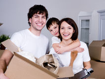 Happy family moving Stock Photos