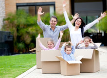 Happy family moving house Stock Photos