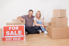 Happy family moving into the new home Royalty Free Stock Image
