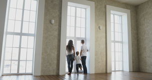 Happy family moving into their new home. Young happy couple moving in new house stock footage