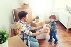 Happy family moving to new home and playing ball Stock Images