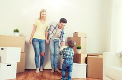 Happy family moving to new home and playing ball Royalty Free Stock Photo