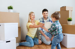 Happy family moving to new home and playing ball Stock Photography