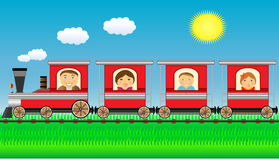 Happy family moving in train with grass. Cheerful family moving in train with grass and sun Royalty Free Stock Image