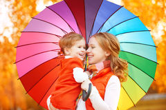 Happy family mum and child daughter with rainbow colored umbrell Royalty Free Stock Photos