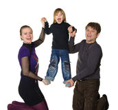Happy family. Mum and the daddy hold the son Royalty Free Stock Images