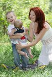 Happy family on natural background Royalty Free Stock Photo