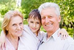 Happy family at nature Stock Photos