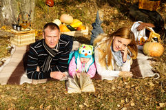 Happy family on nature autumn Royalty Free Stock Image