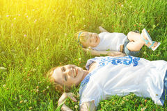 Happy family on nature. mom and baby daughter are playing in the Stock Photography