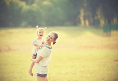 Happy family on nature mother and baby daughter Stock Images