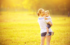 Happy family on nature mother and baby daughter Stock Photo