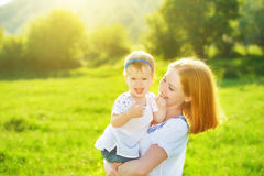 Happy family on nature mother and baby daughter Stock Photography