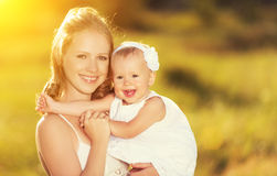 Happy family on nature mother and baby daughter Royalty Free Stock Image