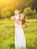 Happy family on nature mother and baby daughter Royalty Free Stock Photo