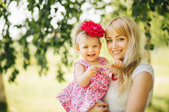 Happy family on the nature of mother daughter Stock Photos