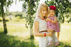 Happy family on the nature of mother daughter Stock Photography