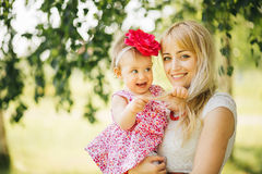 Happy family on the nature of mother daughter Royalty Free Stock Images