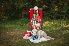 Happy family on nature photoshoot Stock Photo