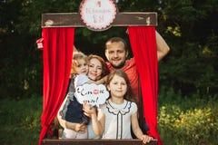 Happy family on nature photoshoot Stock Photos