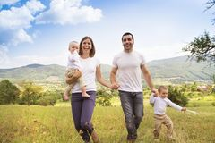 Happy family in nature Stock Photography