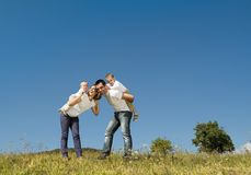 Happy family in nature Stock Photos