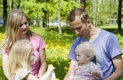 Happy family on the nature of the rest Stock Image