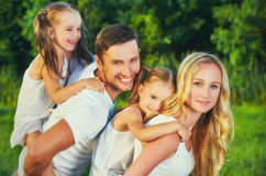 Happy family on nature of summer, mother, father and children tw Stock Photo