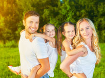 Happy family on nature of summer, mother, father and children tw Royalty Free Stock Photos