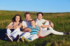 Happy family on nature in summer. stock images