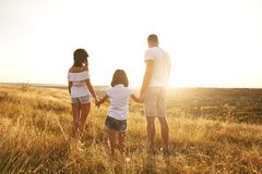 Happy family on nature in summer at sunset. royalty free stock images