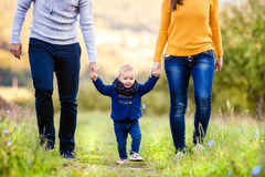 Happy family in nature. Happy young family spending time together outside in green nature royalty free stock photo