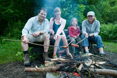 Happy family near campfire Stock Photography