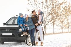 Happy family near car on day royalty free stock photography