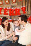 Happy family with near the Christmas background Stock Images