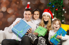 Happy family near the Christmas tree Stock Photo