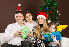 Happy family  near the Christmas tree Stock Images