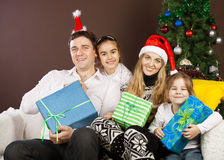 Happy family near the Christmas tree Royalty Free Stock Photos