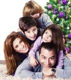 Happy family near Christmas tree royalty free stock images