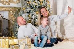 Happy family near Christmas tree. Royalty Free Stock Photo