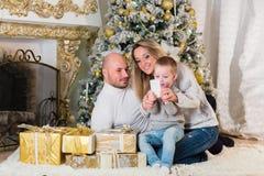 Happy family near Christmas tree. Royalty Free Stock Image