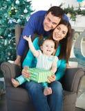Happy family near the Christmas tree Royalty Free Stock Photography