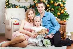 Happy family near christmas tree Stock Images