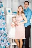 Happy family near christmas tree royalty free stock photography